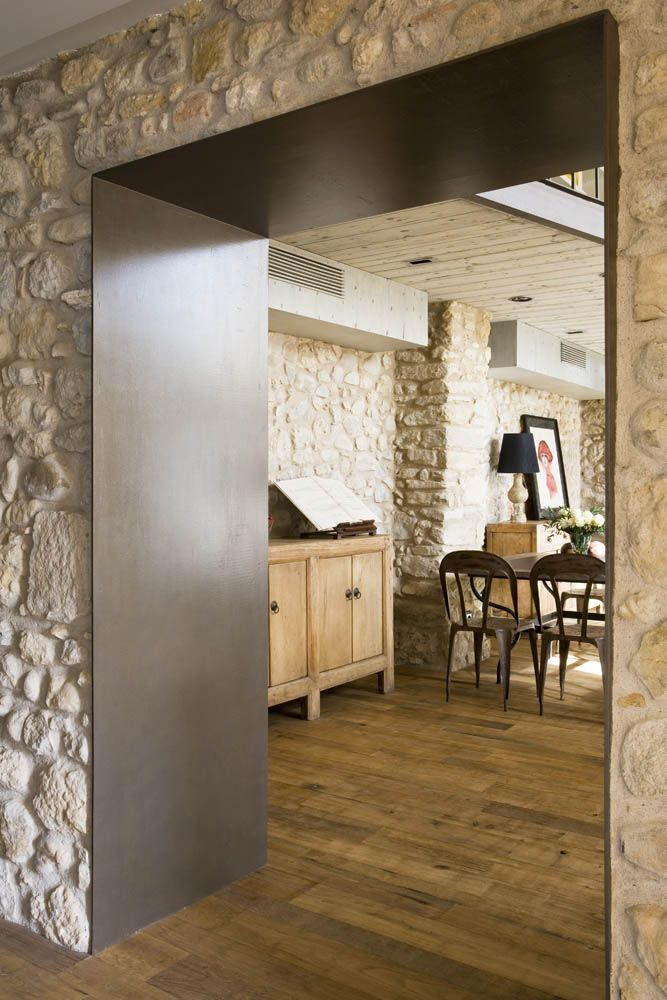 Sant Jordi Desvalls ,crisp metal doorway through stone wal