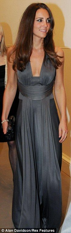 Lady in waiting: Kate Middleton pulls off the regal look in a grey halter-neck dress by Issa at the Starlight Children's Foundation charity event
