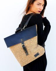 Tote mosaic cork and black leather backpack. Features double interior pocket and black leather front closure and adjustable straps. Created on order.