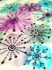Snow flakes doodled over watercolor circles - would make a nice holiday card