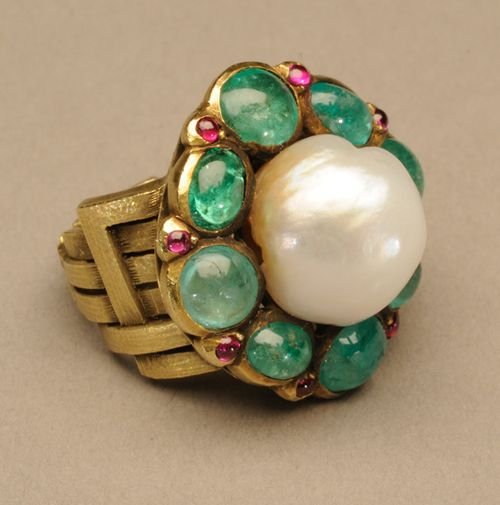 Marie Zimmermann. Ring, by 1922. Gold, baroque pearl, emeralds, pink sapphires and possibly rubies