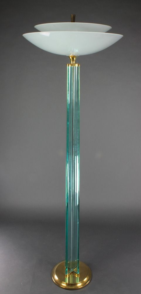 """Lots 1034 and 1035, GIO PONTI designed A handsome Art Deco style glass and gilt mounted uplighter, formed from 4 straight sections of glass and with opaque glass shade etched signs of the Zodiac 73""""h x 24"""" diam., sold for £2,000 and £1,900"""