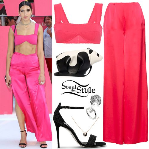 Dua Lipa attended the premiere of Baby Driver in London wearing a Sleeveless Scallop Trim Knit Bra Top ($445.00) and High Waisted Wide Leg Trousers ($875.00) both by Blumarine, a Loewe Leather Panda Mini Bag ($1,290.00), the Hermès Chaîne d'Ancre Enchaînée Ring (€495.00), a Juste Un Clou White Gold Ring ($2,430.00) and her Amulette de Cartier Necklace ($1,890.00) both by Cartier, and René Caovilla Heeled Sandals ($1,920.00 – similar style). You can find a similar top at 6pm ($21.60) and…