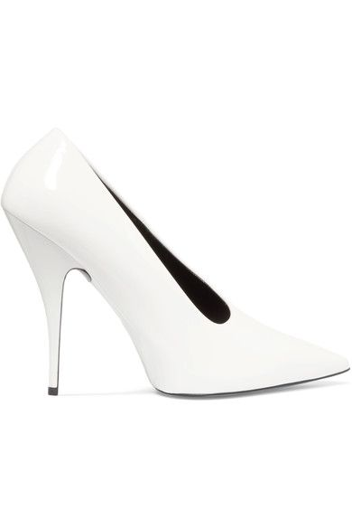 WHITE ACCENTS: Stella McCartney's pumps have been made in Italy from glossy faux patent-leather. Set on a slim 115mm heel, they have an asymmetric vamp and a sleek pointed toe - a key shape for the label this season. We think they work particularly well with tailoring and rolled denim.