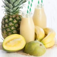 Easy Tropical Smoothie on MyRecipeMagic.com A delicious refreshing smoothie with coconut milk, banana, mango and pineapple.