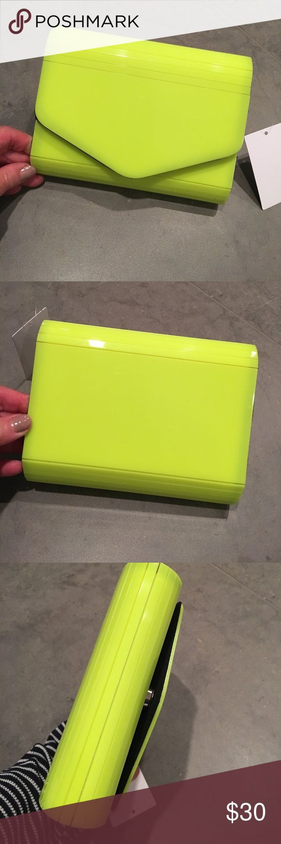 "Neon clutch with chain strap to wear as cross body Neon plastic clutch measures 7"" x 5.5"" with 47"" chain strap to carry as cross body purse.  NWT Bags Clutches & Wristlets"