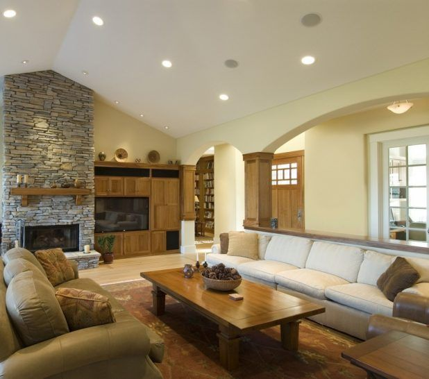 Elegant living room interior design ideas with brick gray ignition and beige wall also white and dark beige seat sofa soft sponge complete cushion also small brown wooden table using carpeted flooring designs