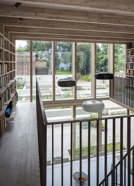 East London House by David Mikhail Architects  2 level glass extension with bookshelves and gallery