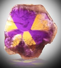 This beautiful Ametrine Crystal is a fusion of Citrine and ...