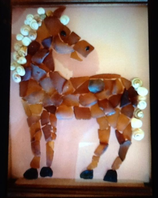 Horse made out of sea glass and shells from Ponte Vedra Beach, fl.