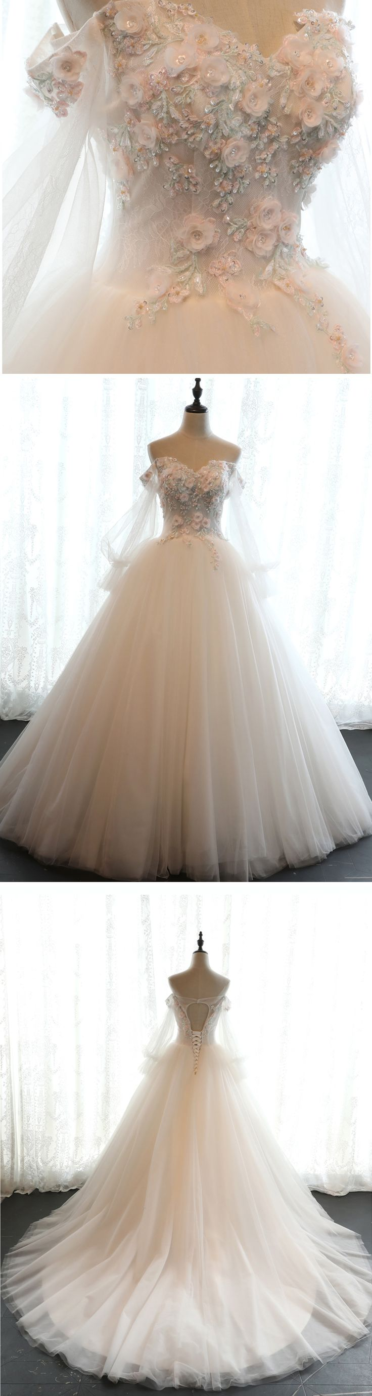 Beaded white tulle off shoulder wedding dress