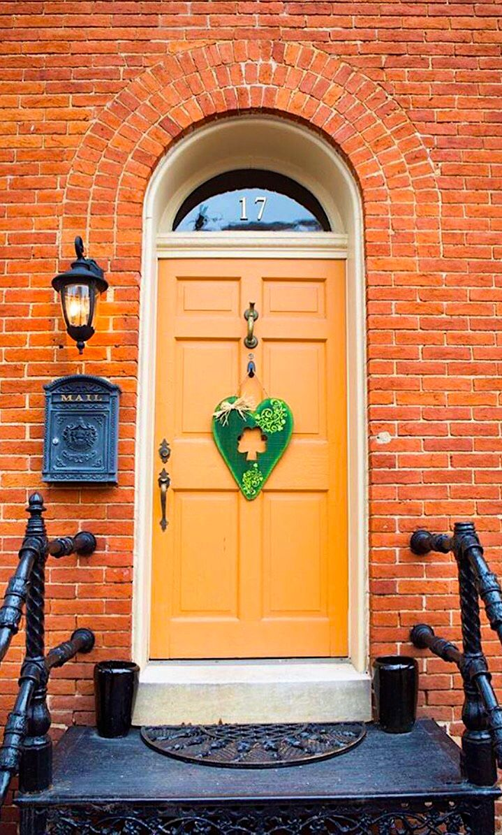 Orange door in Frederick, Maryland.