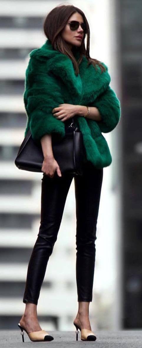 amazing winter outfit / green fur jacket bag black skinnies heels