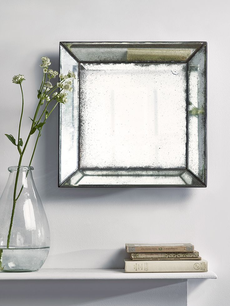Backed in wood with a black painted finish, this Venetian style weighty mirror has a wide bevelled edge and square centre. This weighty, three dimensional mirror has an antiqued finish underneath the glass, with mottled details and a vintage, rustic look.
