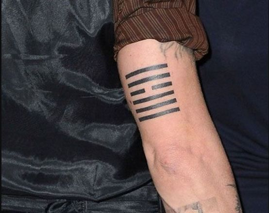 Johnny Depp often gets matching tattoos with his best friends. He has several matching tattoos with Marilyn Manson. He got a Ching tattoo on the back of his right bicep and it denotes winds over heaven.