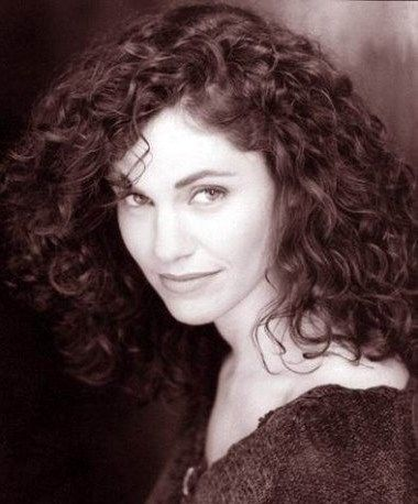 Curly hair natural. Picture of Amy Brenneman with curly long hair style. Brown loose, big, side parted, eye-concealing, semi-formal down hair with fringe (bangs) and highlights. Celebrity hairstyle photo.