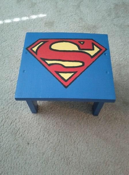 Made a wood step stool painted with Superman symbol for reaching bathroom sink since grandson is such a fan.