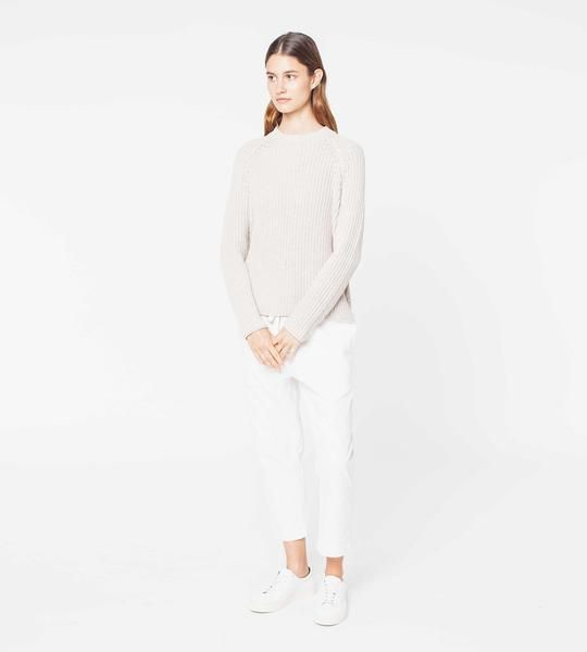 The Sunday Knit is a medium weight with minimal seams and a fitted neck opening. Small side splits and a lowered back hemline give this jumper a relaxed charact