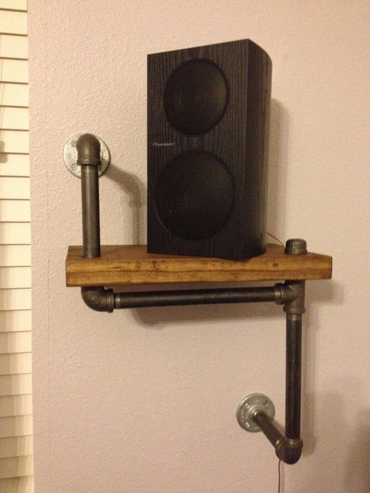The other speaker stand made by husband and me. Black steel pipes, stained pine board.
