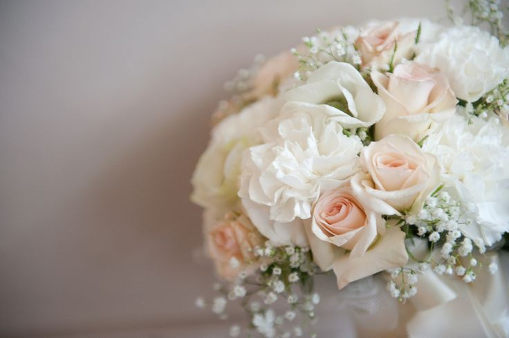 Soft peach and white bridal bouquet with baby's breath ...
