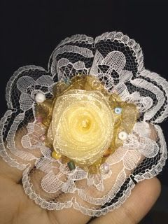 yellow flower ribbon and lace brooch