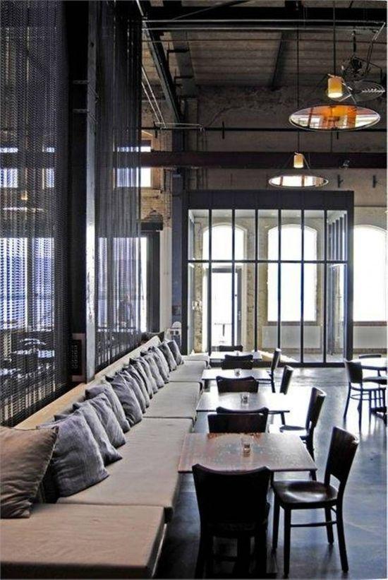 Cafe interior design long buffet seating with pillows - Interior design cafe milano ...