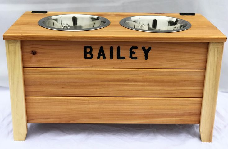 Excited to share the latest addition to my #etsy shop: Raised dog bowl with storage. Pet supplies. stainless steel dog bowl. Custom name. Dog feeder. Cedar. Rustic. Stainless steel dog bowl. http://etsy.me/2FaCyO4 #furniture #storage #mothersday #wood #clear #housewarm