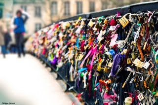 Lover's Bridge - Paris, France  Couples are supposed put the lock on the fence and throw the key in the water so that they will stay together forever.