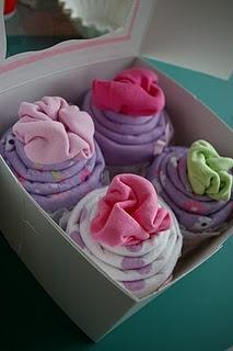 baby onesie cupcake tutorial = using four onsies and four receiving blankets
