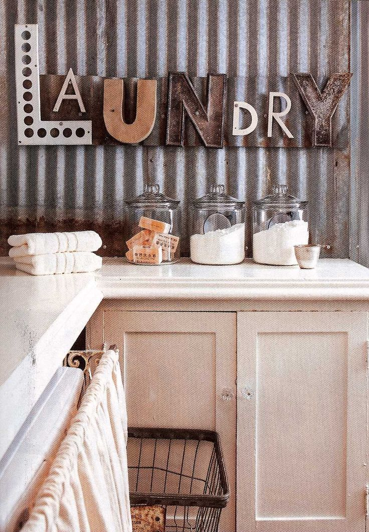 Fabulous laundry room with LAUNDRY repurposed letters as wall decor.....Does anyone know the source of this pin? It doesn't lead to the post