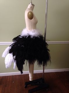 use a white tutu as a base and add white feather boas over the top in layers to create a fat duckling