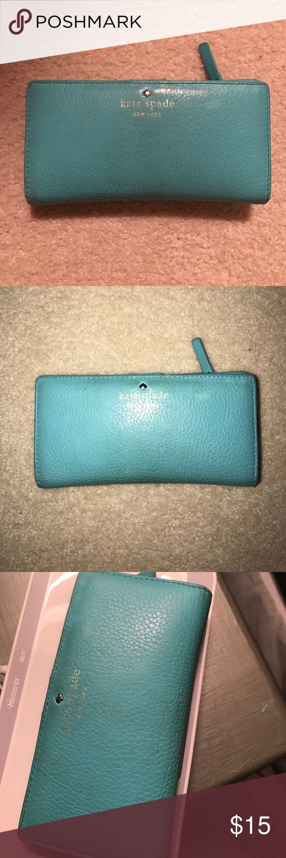 "SALE Kate Spade Jackson Street Stacey Wallet Pebbled leather turquoise wallet. Snap button close. Change pocket, 12 card slots, ID slot, and 4 slots for cash. Fading, signs of wear, and markings as shown in pictures. Dimensions are 6.6"" L x 3.5"" H x 0.5 D as taken from Kate Spade website. kate spade Bags Wallets"