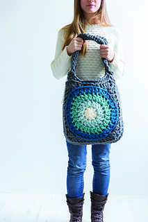 Carry everything you need in this perfectly-sized bag. It's based on a giant circular-centred granny square motif and crocheted by holding two strands of yarn together.