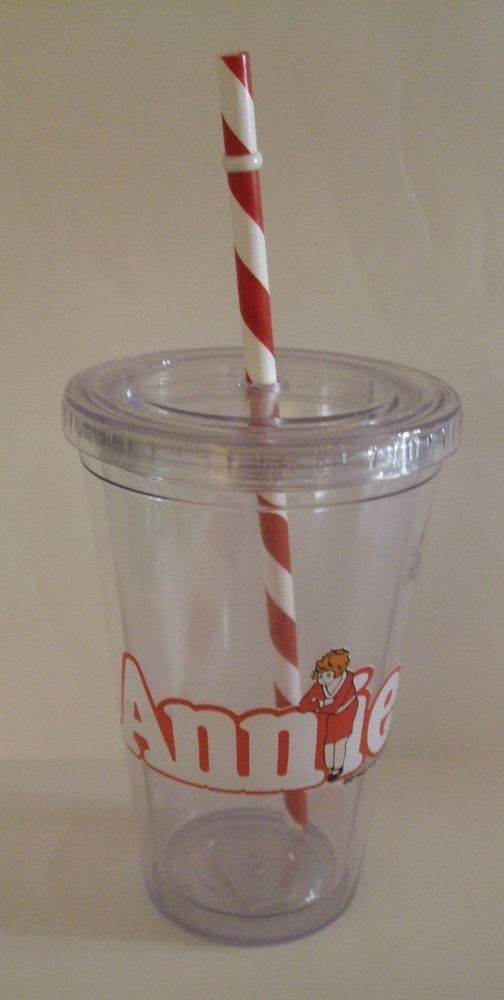 Sipping from this Annie the Broadway Musical plastic glass will