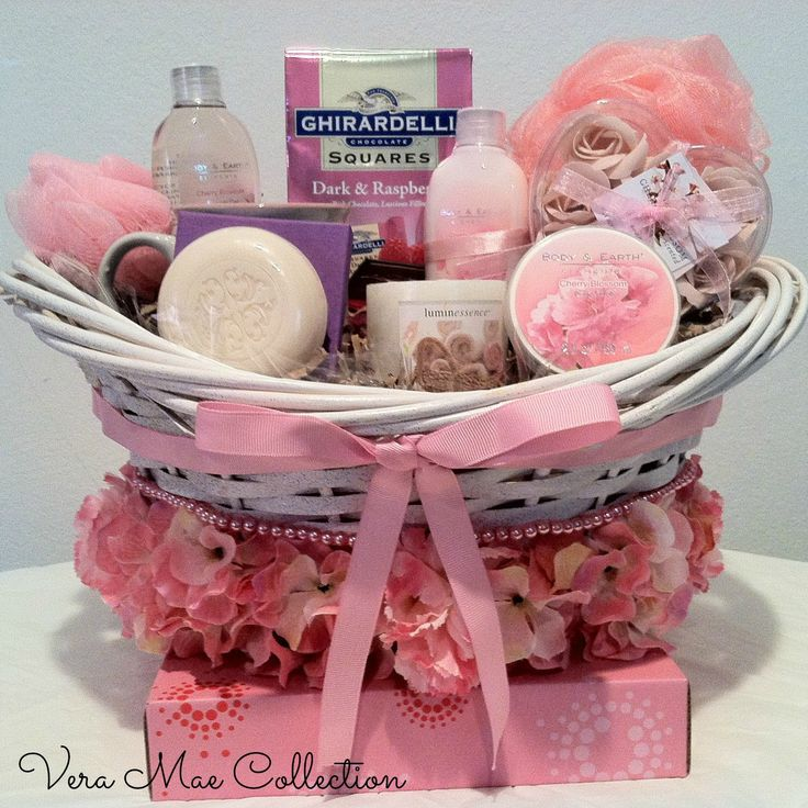 Give her the royal treatment with this luxurious spa gift basket featuring Cherry Blossom  1 Shower Gel 1 Body Lotion 1 Body Scrub 1 Mini Sponge 1 Body Sponge 1 Cup 1 Candle 1 Soap Rose Petals 1 Soap Bar Ghirardelli Chocolate Squares Dark & Raspberry Rich Chocolate, Luscious Filling.