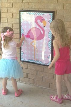 Pin the feather on the flamingo birthday party game - I would change to flower