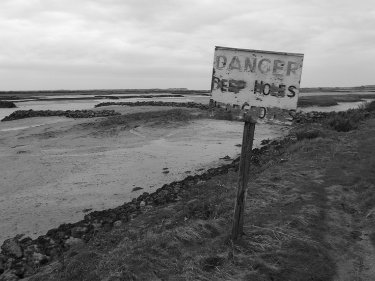 Low Tide, Burnham Overy Staithe. This image in black and white gives the mud flats at low tide an ominous look and feel.