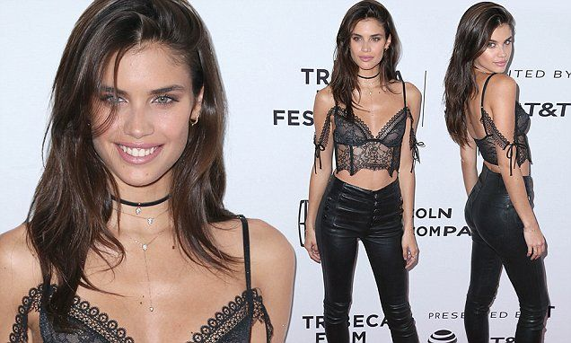 Sara Sampaio stuns in black lace bustier and tight leather pants