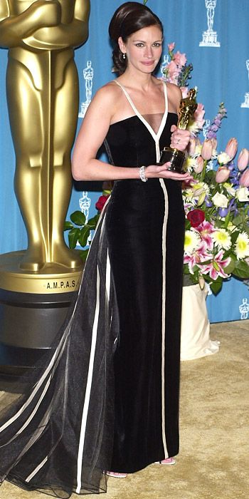 "JULIA ROBERTS, 2001 Julia Roberts accepted her Oscar for Erin Brockovich in a dramatic velvet-and-satin vintage Valentino gown from the designer's 1982 collection dedicated to movie stars. Valentino told InStyle, ""This dress made me nervous. You are never sure who is going to wear what until they walk out onto the stage. That night I was in Rome, watching the Oscars live on television, and I stayed up until the wee hours of the morning to see if she wore it."""