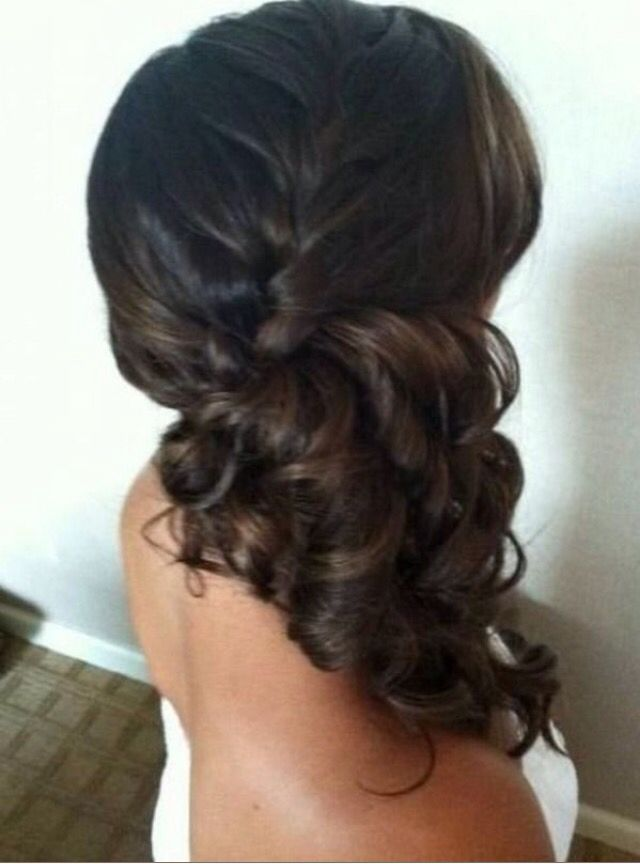 A brunette beauty showing off this gorgeous side pony with a braid and flawless …
