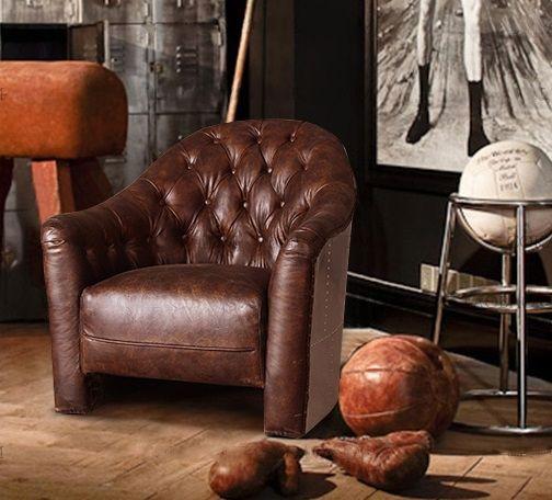 Полукруглое кожаное кресло темно-коричневого цвета с подлокотниками в интерьере стиля лофт можно купить на странице магазина https://lafred.ru/catalog/catalog/detail/43689921794/