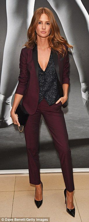 Suited and booted! Looking effortlessly glamorous for the outing, Millie, 27, opted for a burgundy trouser suit that flattered her lithe frame