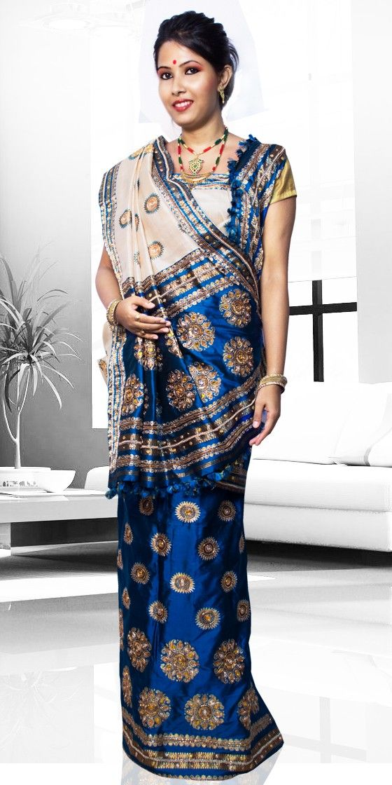 Beautiful Blue and Golden colour Assam Silk Pat Chumki Contrast Mekhla Chadar. This is a traditional Wedding collection with artistic chumki work.The set is outlined with Naksi Stone and thread.This is a three piece set i.e.Chaddar, Mekhala and Blouse Piece. The Mekhla Chadar comes with matching blouse piece, the blouse shown in the image is just for display purpose.Slight colour variation may be there in display & actual.