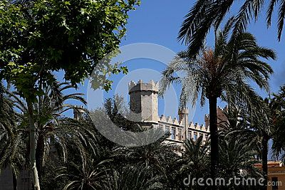 The top of the building in Moorish style between the tufts of trees in Palma de Mallorca. Mallorca, Spain