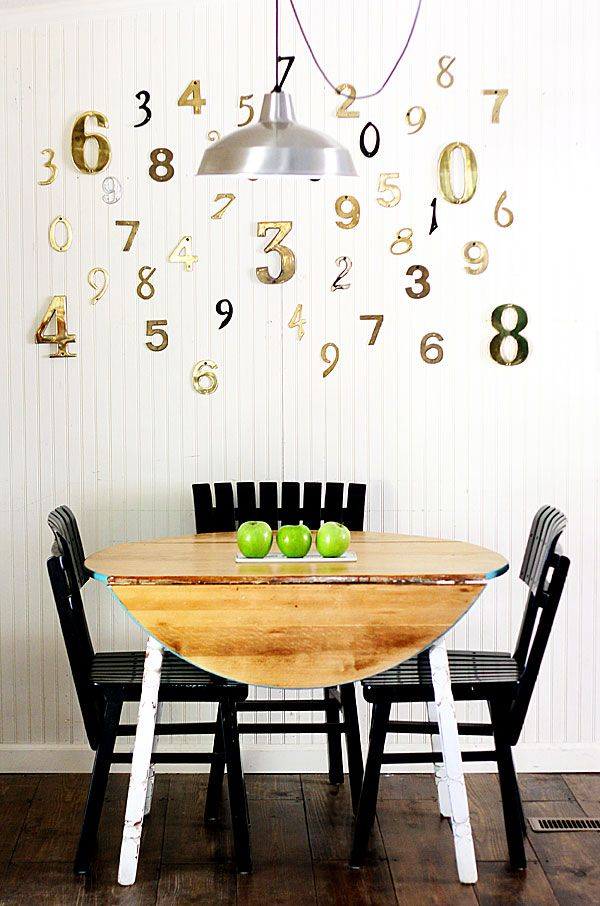 Decorate a blank wall with house numbers like this idea from The Shabby Creek Cottage.