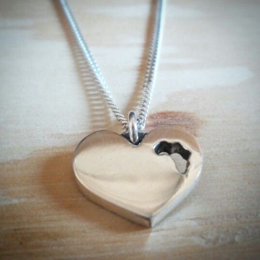 Sterling silver heart pendant with Africa cut out. By lil Rose Jewellery.