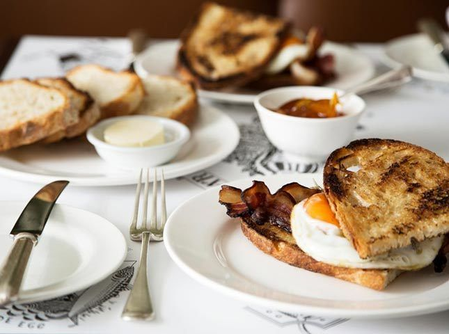 BRUNCH - This handsome Soho dining room is full of charm, offering sophisticated menus at affordable prices. Order: The Bacon Manchet – a toasty little bun filled with crispy, meaty bacon and a perfectly fried egg – is a great take on the classic bacon sandwich. 26-29 Dean Street, London, W1D 3LL; quovadissoho.co.uk   - HarpersBAZAAR.co.uk