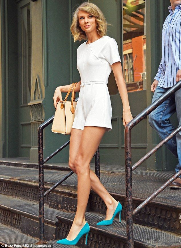 Turning heads: The singer looked amazing in a skimpy white romper which left her long and slender legs on show