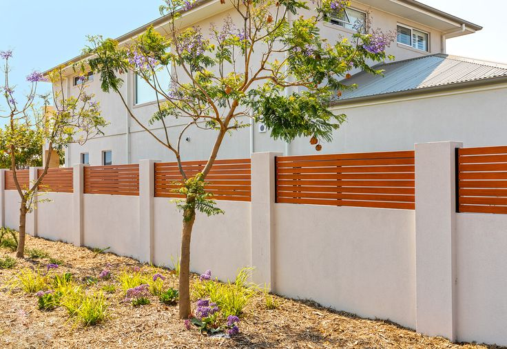 Keep your boundary private and stylish just like this Adelaide home, using a Tuscan style texture rendered finish, flush capping and aluminium slats.