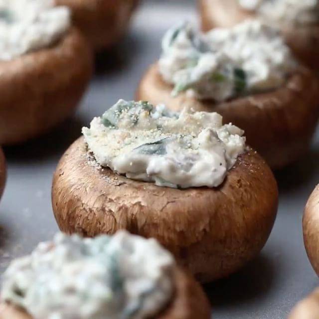 Creamy Spinach-Stuffed Mushrooms Serves 5 (makes 20 mushrooms)  INGREDIENTS 20 medium-sized mushrooms 1 tablespoon butter 2 cloves garlic, minced 4 cups fresh spinach 8 ounces cream cheese Salt Pepper ¼ cup bread crumbs ¼ cup parmesan  PREPARATION 1. Preheat oven to 375˚F/190˚C. 2. Remove the stems from the mushrooms. Place the top half on a baking sheet and mince the stems. 3. Melt the butter in a pan and add the minced stems and minced garlic. Stir and cook for 2 minutes. 4. Add the…